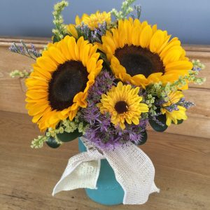 Garden sunflowers in a mason jar.
